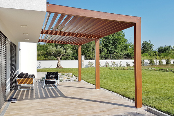 Pergola on passive house with large panoramic windows